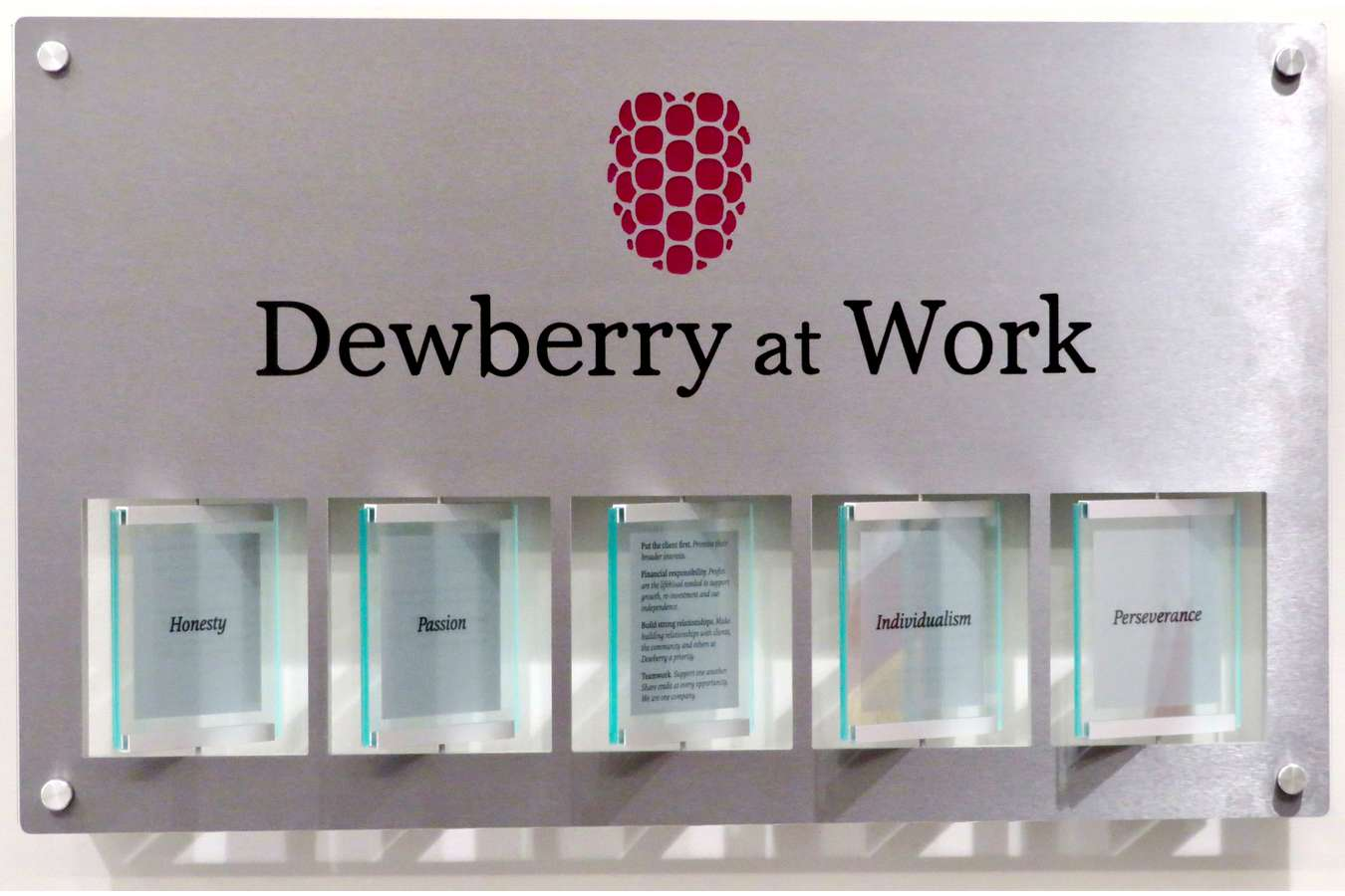 Dewberry Spinner : Spinner plaques encourage visitors to read Dewberry's 5 Qualities in corporate lobbies
