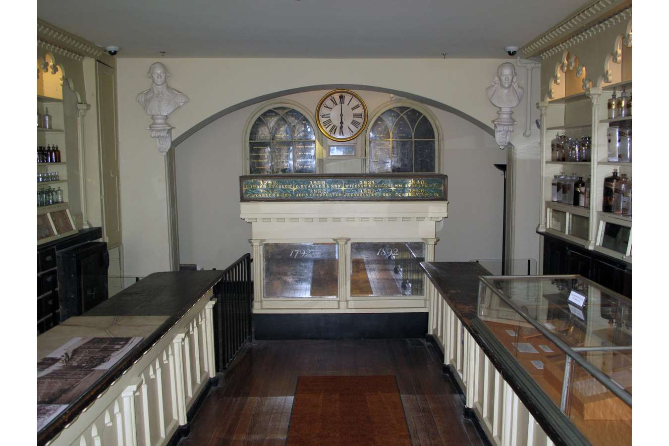 Apoth 7852 : Restored busts of George Washington and Ben Franklin and clock returned to arched wall